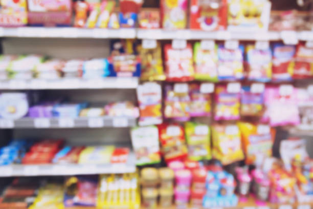 blur photo background of snacks and consumer product colorful in supermarket shop shelf. Mini-mart shopping convenience stores are a new alternative for the urban people concept blur photo background of snacks and consumer product colorful in supermarket shop shelf. Mini-mart shopping convenience stores are a new alternative for the urban people concept snack aisle stock pictures, royalty-free photos & images