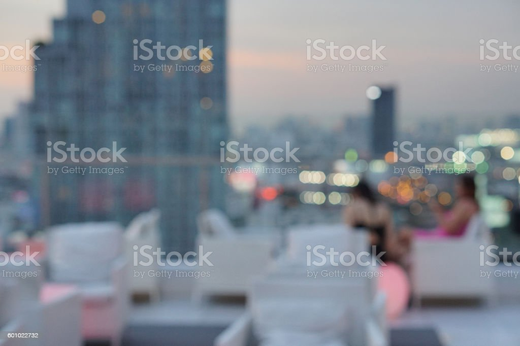 blur photo of people at  luxury rooftop bar – Foto