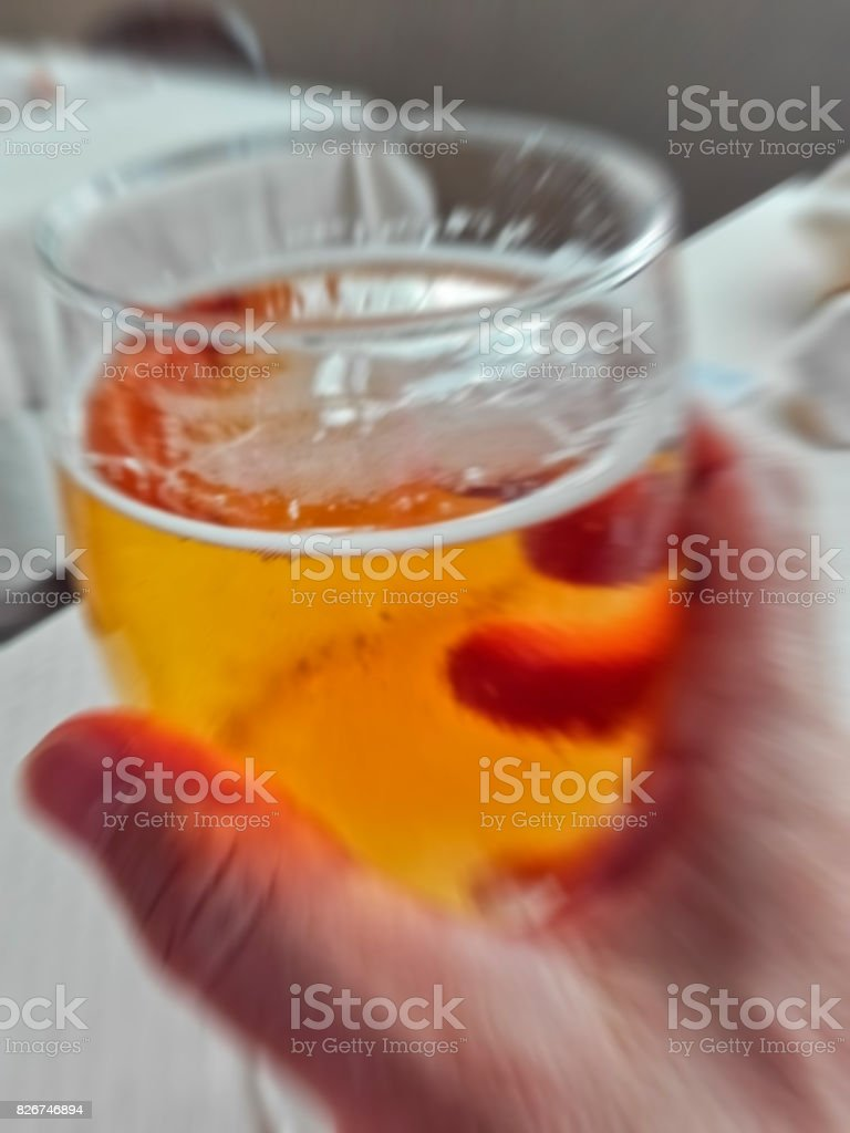 blur picture of a beer glass in man's  hand to simulate overdrink stock photo