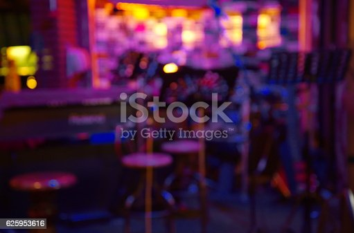 istock blur purple light in bar music instrument  at night 625953616
