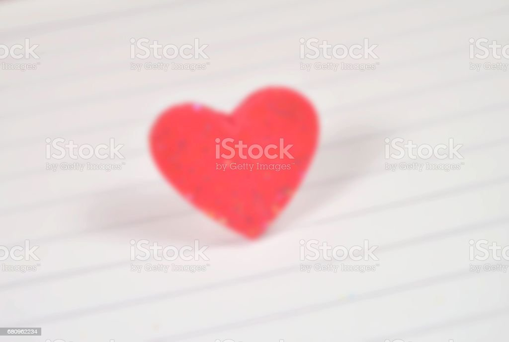 Blur red heart on white paper for background royalty-free stock photo