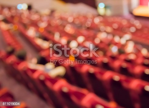 blur row of  empty red auditorium or theater seat