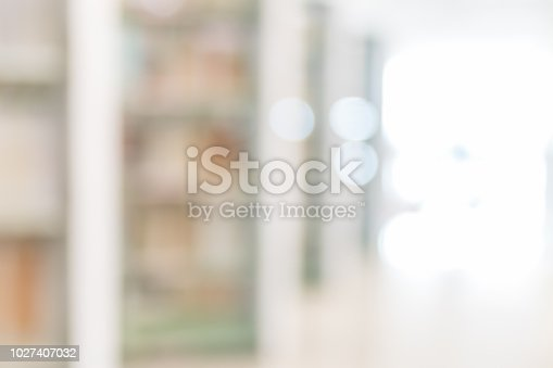 istock Blur school library or study room with book shelves for education background 1027407032