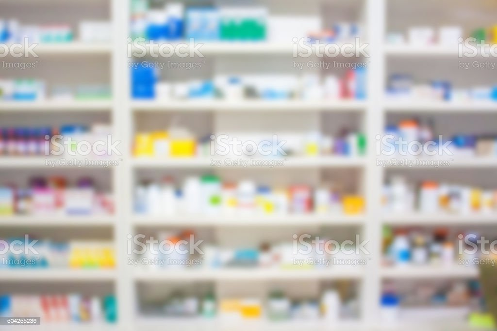 blur shelves of drugs in the pharmacy stock photo