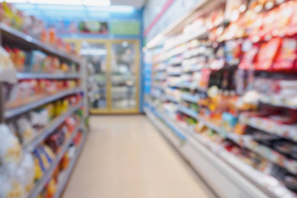 blur snack, food, milk and dairy products shelves in supermarket convenience store stock photo