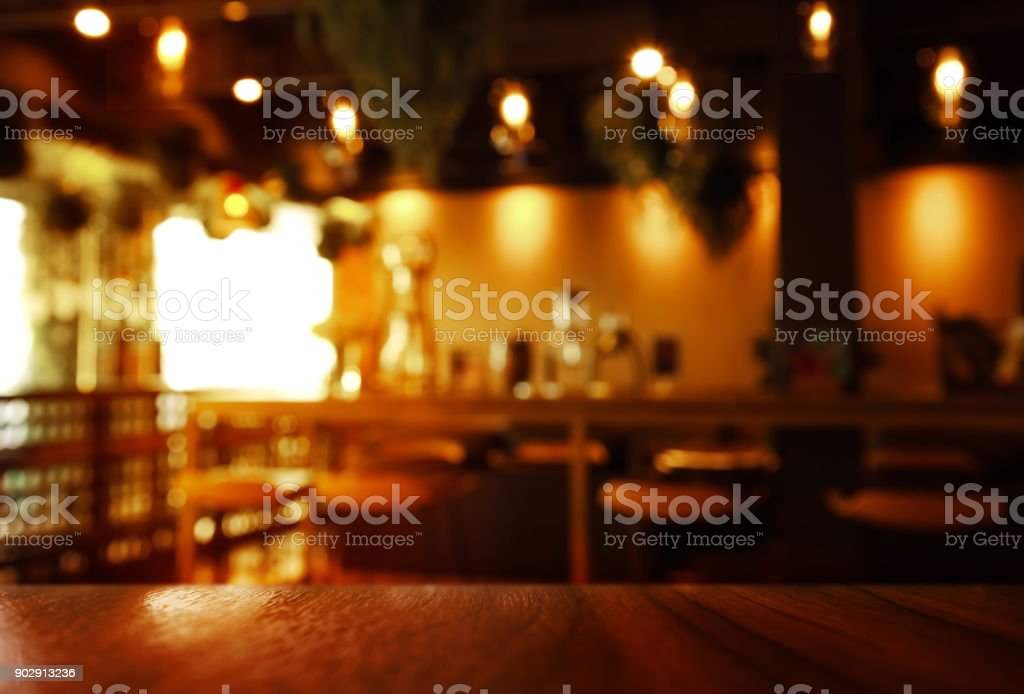blur top of wood table with dark light cafe or bar interior background stock photo