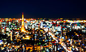 Asia Business concept for real estate and corporate construction - blur view of Tokyo Tower with colorful neon light in Roppongi Hill, Tokyo, Japan