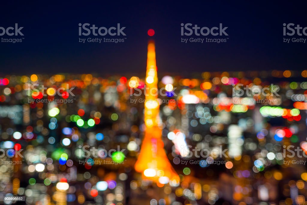 blur view of Tokyo Tower with colorful neon light stock photo