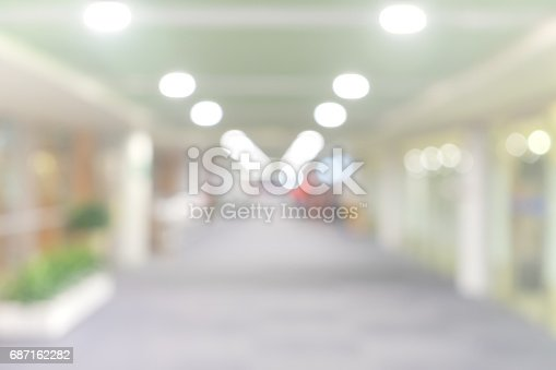 istock blur walkway in the building at night for abstract background. 687162282