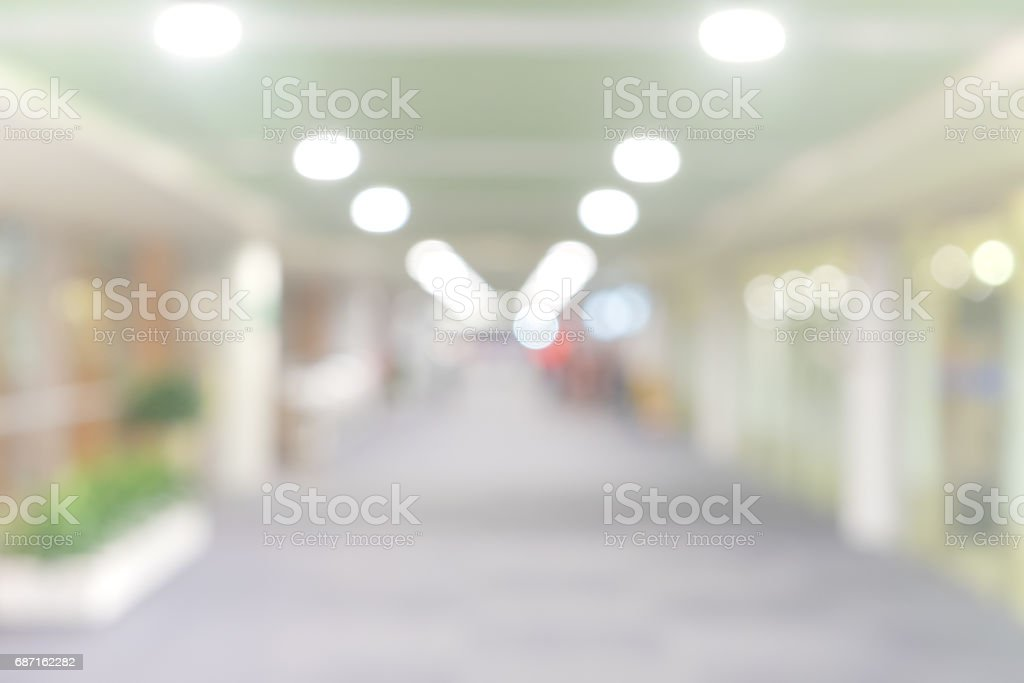 blur walkway in the building at night for abstract background. stock photo