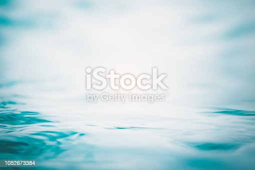 istock Blur water background wavy clean fresh water in light cool cyan turquoise blue green vintage color 1052673384