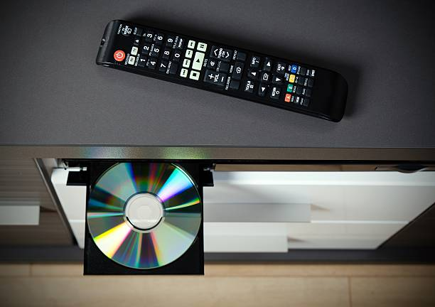 blu-ray or dvd player with inserted disc - blu ray disc photos et images de collection
