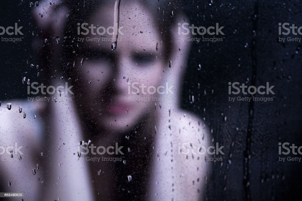 Blured image of depressed girl stock photo