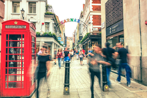 Blured people walking in Carnaby in London Blured people walking in Carnaby in London carnaby street stock pictures, royalty-free photos & images