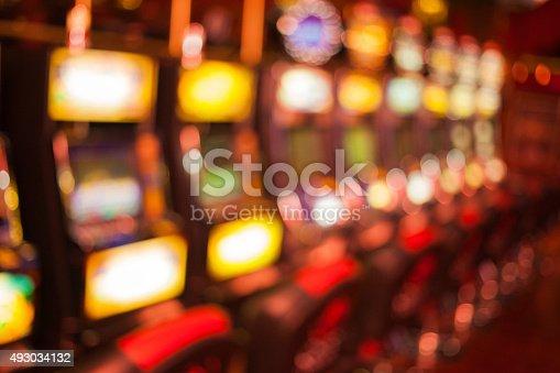 istock Blured slot machines in Casino 493034132