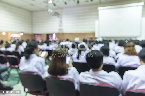 istock Blurred abstract background full seat rows in business or educational conference presentation in auditorium hall 1138281376