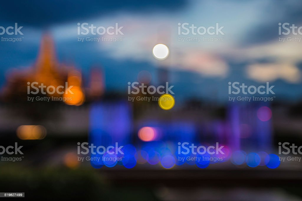 Blurred abstract background lights, beautiful fountain front of royal temple stock photo