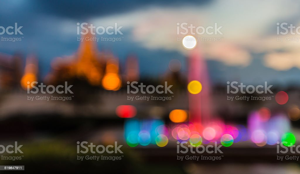 Blurred abstract background lights, beautiful fountain front of temple stock photo