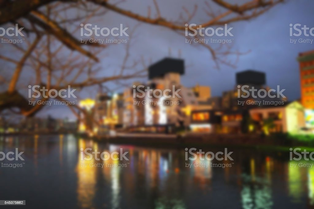Blurred abstract background of Buildings on the waterfront at night stock photo