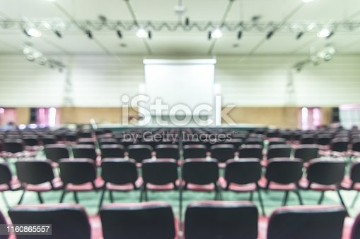 istock Blurred abstract background of business or educational conference and seminar in auditorium hall 1160865557