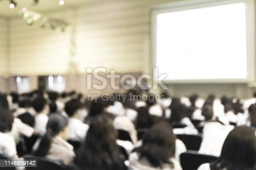 istock Blurred abstract background of business or educational conference seminar in auditorium hall 1148939142
