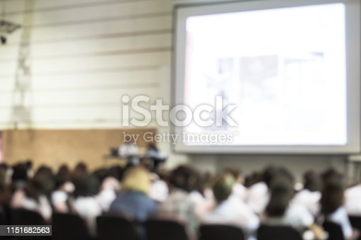 istock Blurred abstract background of business or educational conference seminar in auditorium hall 1151682563