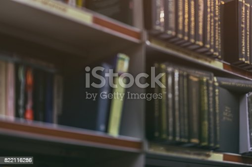 istock Blurred abstract background of Many books, textbooks or fiction volumes Fiction in book store, in library. Concept of education, school, study, self-study 822116286