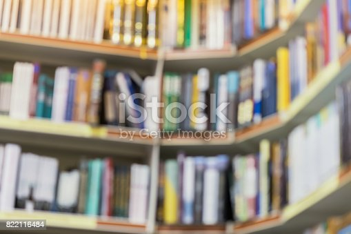 istock Blurred abstract background of rows of different colorful books lying on shelves in library or in modern urban bookshop. Self-study, educational, manuals, textbooks, school, study concept 822116484