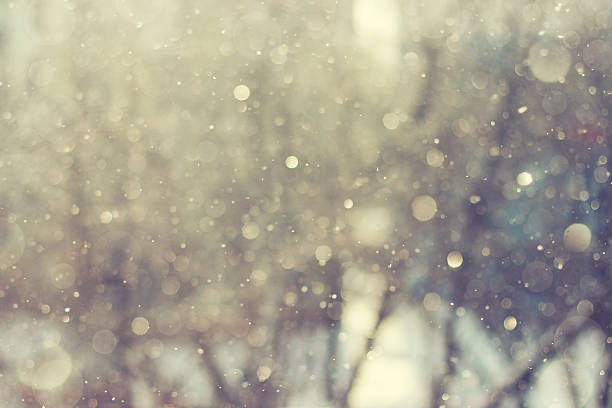 Blurred abstract background. Sunlight winter snowflake backgroun stock photo
