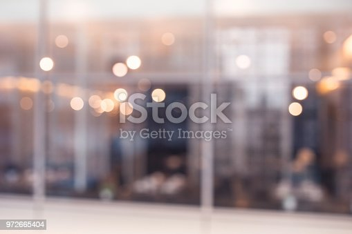 924418868 istock photo Blurred abstract glass wall cafe,restaurant background.material decoration design 972665404