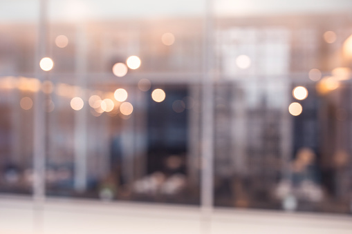 664975574 istock photo Blurred abstract glass wall cafe,restaurant background.material decoration design 972665404