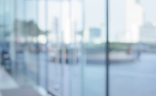 664975574 istock photo Blurred abstract glass wall from building in city town 1144399822