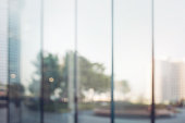 istock Blurred abstract glass wall from building in city town 1144399830
