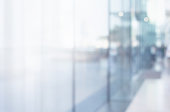 istock Blurred abstract glass wall from building in city town 1144649641