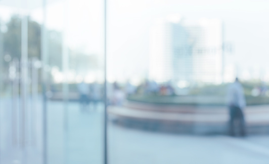 664975574 istock photo Blurred abstract glass wall from building in city town 1144649659