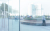 istock Blurred abstract glass wall from building in city town 1144649659