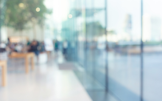 664975574 istock photo Blurred abstract glass wall from building in city town 1145489458