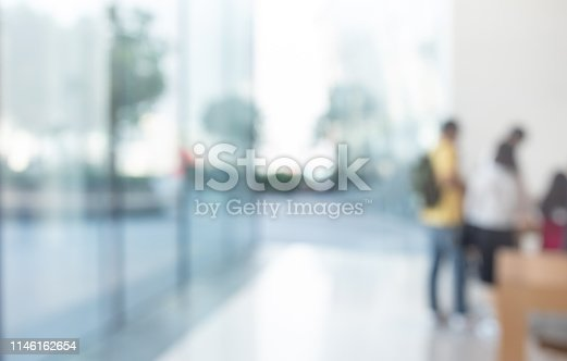 924418868 istock photo Blurred abstract glass wall from building in city town 1146162654