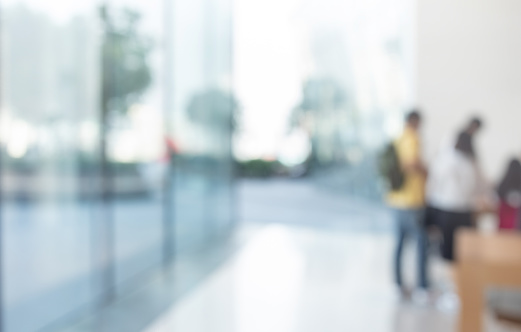 664975574 istock photo Blurred abstract glass wall from building in city town 1146162654