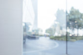 istock Blurred abstract glass wall from building in city town 1146162793