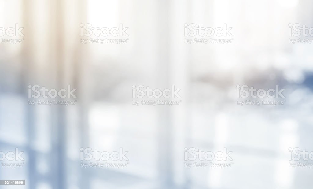 Blurred abstract  grey glass wall building background.