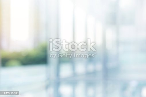istock Blurred abstract  grey glass wall building background. 962595708