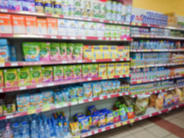 Blurred abstract image. Goods on the shelf of a grocery store. Different baby food
