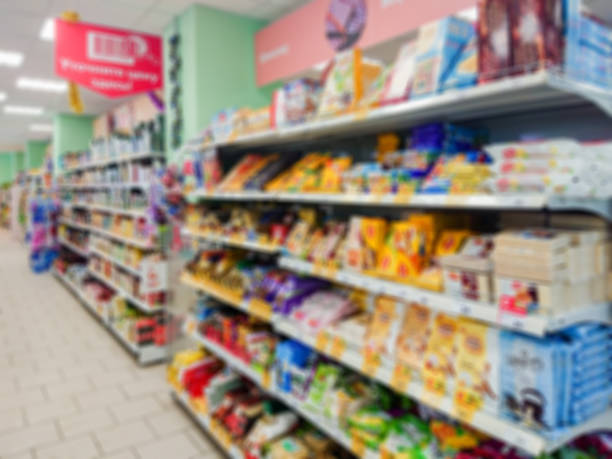 Blurred abstract image. Goods on the shelf of a grocery store. Cookies, waffles, candy and other confectionery on the shelves