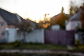 istock Blurred abstract image of country house at sunset 1181372336