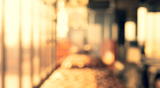 664975574 istock photo Blurred abstract light gold glass wall from building room 1154515169