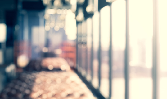 664975574 istock photo Blurred abstract light gold glass wall from building room 1154515177