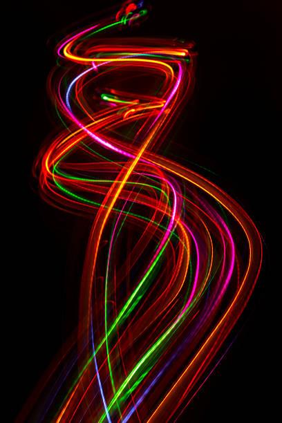 blurred abstract line from led light. - schwarze schlange stock-fotos und bilder