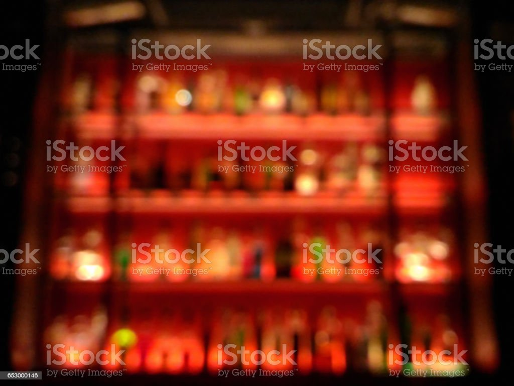 Blurred abstract vibrant bar shelves in the club