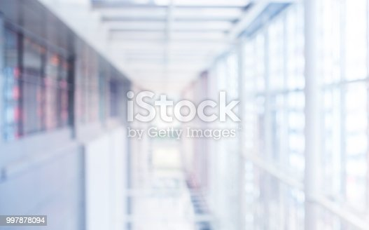 924418868 istock photo Blurred abstract wall building with big window glass background.material decoration design 997878094
